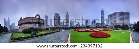 China Shanghai city skyline at sunrise around People's square with major buildings - museum, theater, skyscrapers and green grass with flowers - stock photo