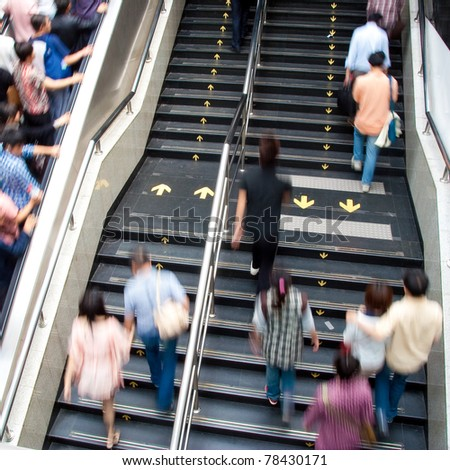 China, Shanghai subway station stairs and people - stock photo