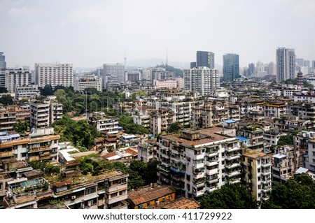 China urban cityscape. Guangzhou city, Guangdong province. Skyscrapers and slums. - stock photo