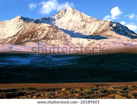China/xinjiang hiking: snow mountain when sunrise near Black Lake - stock photo