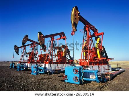 China/xinjiang: oil pumping unit in kelamay city - stock photo