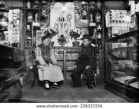 Chinatown, receiving New Year's guests, circa 1900-1930.