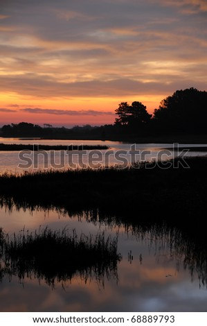 Chincoteague Sunrise Vertical With Copy Space - stock photo