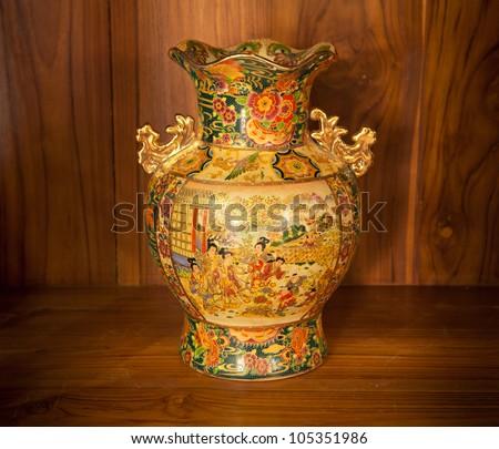 Chine vase gold on the wood - stock photo