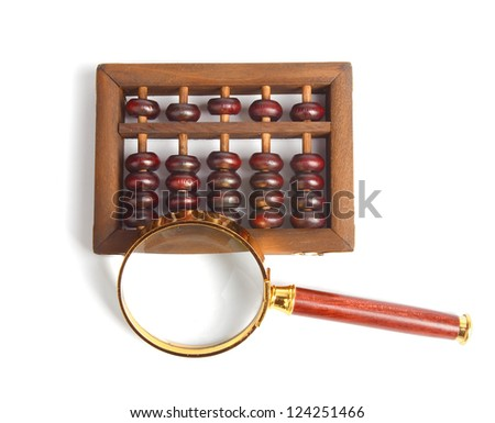 Chinese abacus and Magnifying glass,business concept - stock photo