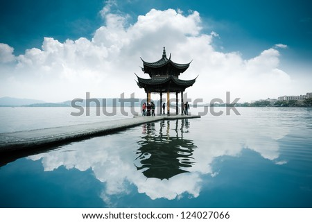 chinese ancient pavilion on the west lake in hangzhou - stock photo