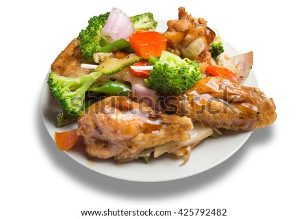 chinese and peruvian food: chicken with vegetables.