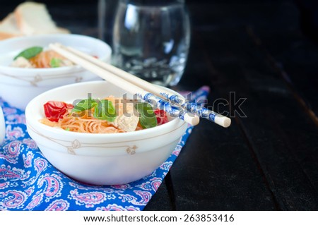 Chinese asian noodles stir fry with vegetables served with a pair of chopsticks - stock photo