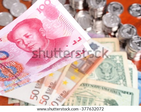 Chinese Bank note in front of  Euro and US Dollar notes. - stock photo