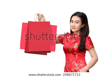 Chinese beautiful asian woman dress traditional cheongsam holding red shopping bag isolated on white background, Happy chinese new year - stock photo