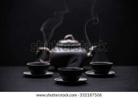 Chinese black teapot and teacups  - stock photo