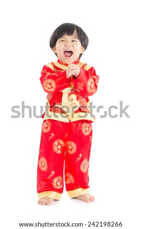 Chinese boy in wishing gesture