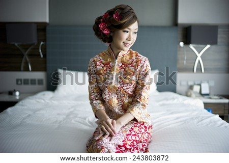 Chinese bride in traditional gown  - stock photo