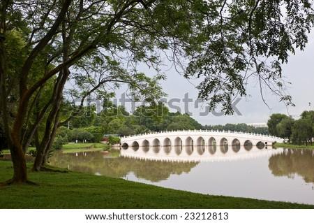 chinese bridge across a river - stock photo