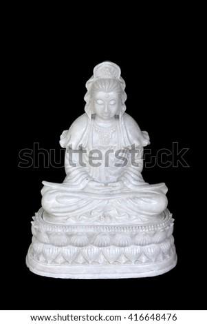 Chinese Buddha marble sculpture Kuan Yin on black background - stock photo