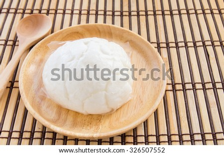 Chinese bun in wooden plate on wood background