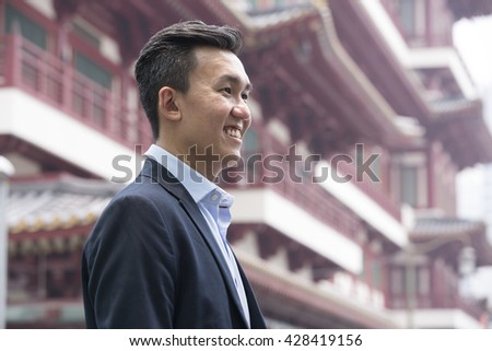Chinese business man in Asian city. - stock photo