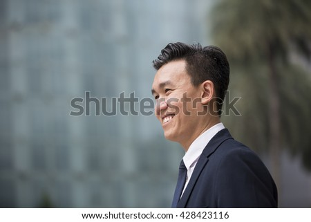 Chinese business man in modern Asian city.  - stock photo