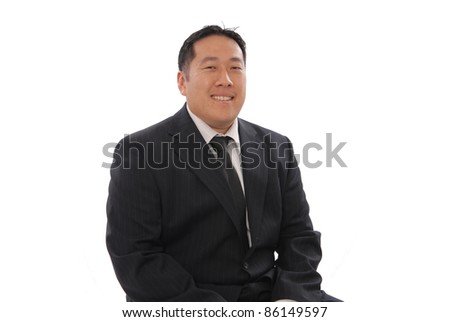 Chinese Business Man Smiling - stock photo