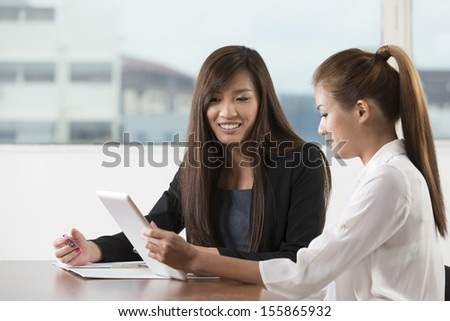 Chinese business team having a meeting in the office. - stock photo