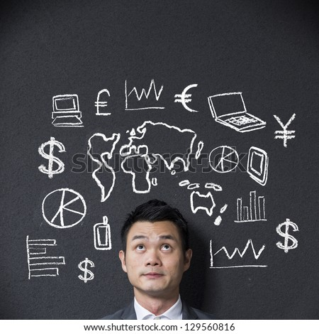 Chinese businessman in front of a sketch or diagram about business and Commerce - stock photo