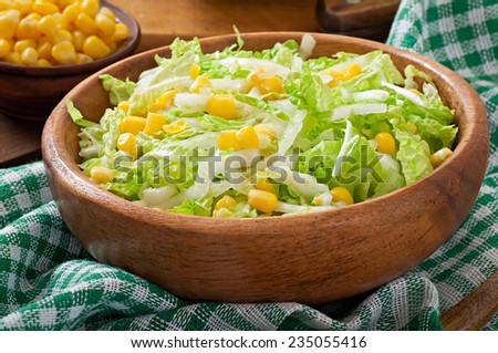 Chinese cabbage salad with sweet corn in a wooden bowl - stock photo