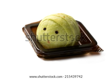 chinese cake that made as a cute worm in a plastic package - stock photo