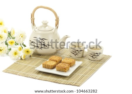 Chinese cake with Tea on bamboo mat - stock photo