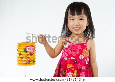 Chinese children holding latern celebrate mid-autumn festival (moon cake festival) in plain white isolated background. - stock photo
