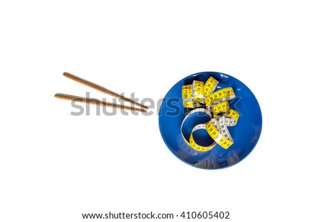 Chinese chopsticks  and measuring tape on plate isolated on white - stock photo