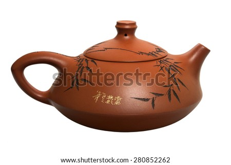 Chinese clay teapot isolated on white background. - stock photo