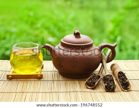 Chinese clay teapot with puer tea  - stock photo
