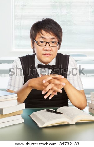Chinese collage male student pose to the camera - stock photo
