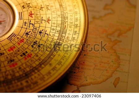 Chinese compass(Luo pan) over map of China. - stock photo
