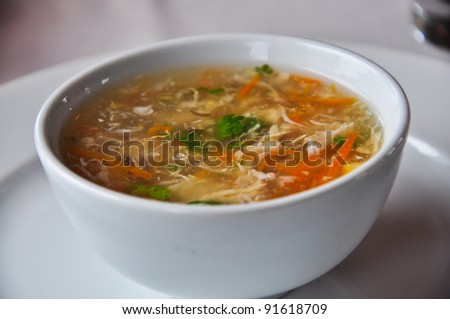 Chinese crabmeat soup with carrot and corn - stock photo