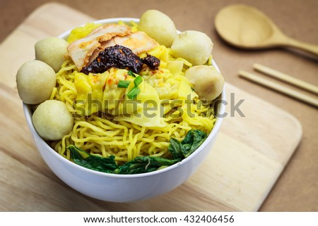 Chinese cuisine, egg noodles ,noodle spicy dumpling with fish balls, Street food,Thailand - stock photo
