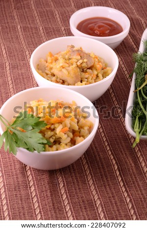 Chinese cuisine - fried rice with meat on wooden background