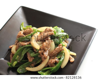 Chinese cuisine, green pepper and beef stir fried - stock photo