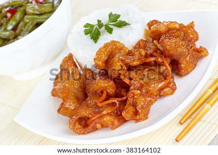 Chinese cuisine. Pork in batter and sweet and sour sauce - stock photo