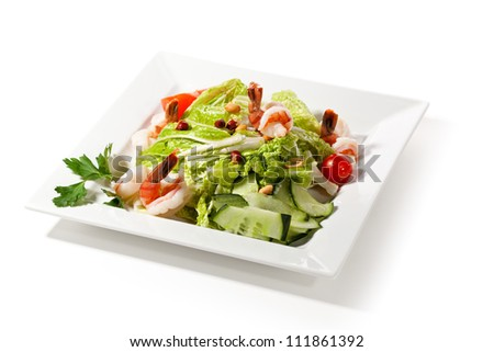 Chinese Cuisine - Tiger Shrimps Salad with Sliced Tomato and Sliced Vegetables - stock photo