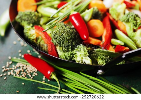 Chinese cuisine. Wok cooking vegetables. Vegetarian wok - stock photo