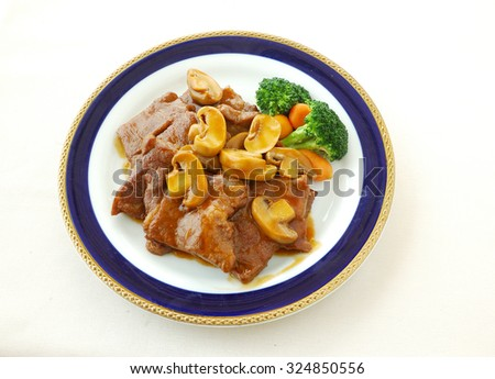 chinese cuisine. yumcha, chinese food.Veal chop with oyster sauce. - stock photo