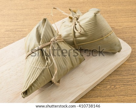 Chinese Cuisine, Zongzi or Sticky Rice Dumpling for Dragon Boat Festival. - stock photo