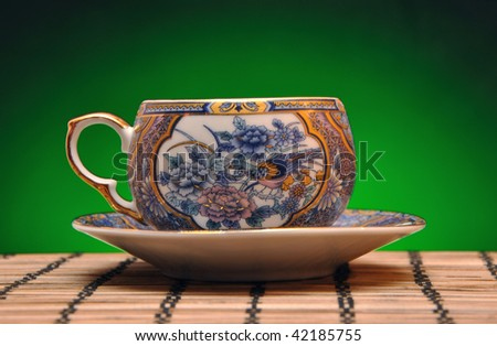 chinese cup with floral decor - stock photo