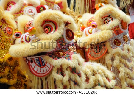 Chinese dancing lion head in golden color - stock photo