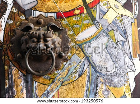 Chinese door with a lion hand door - stock photo