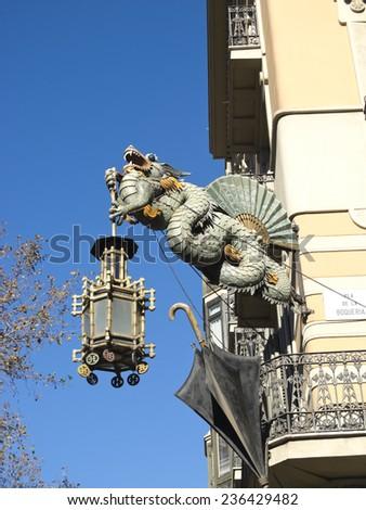Chinese Dragon and umbrella, modernism architecture (Casa Bruno Cuadros), in the Ramblas. Barcelona, Catalonia, Spain. - stock photo