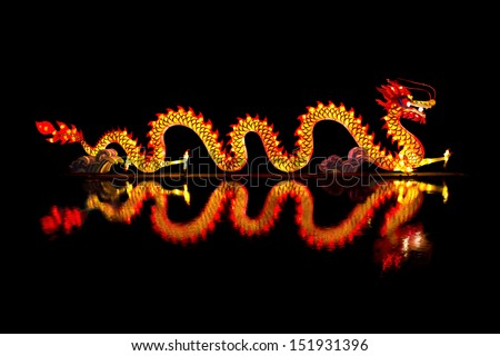 Chinese Dragon Lantern on pond - stock photo