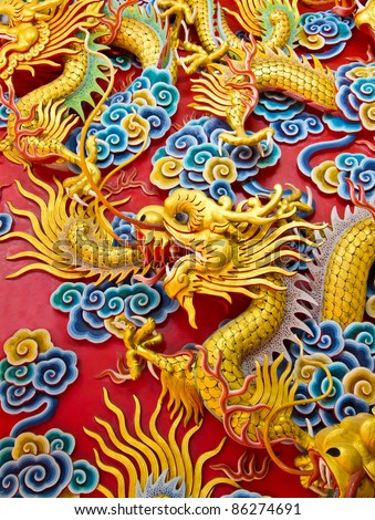 chinese dragon on temple wall - stock photo