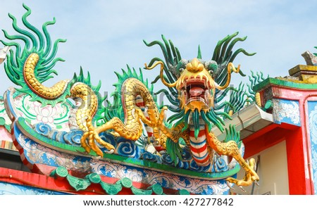Chinese dragon statue on the roof. - stock photo
